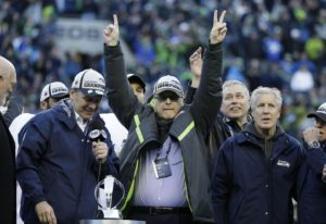 Seattle Seahawks owner Paul Allen celebrates after the NFC Championship game against the Green Bay P