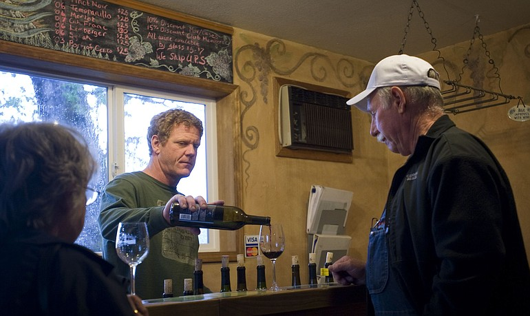 Wind River Cellars owner Joel Goodwillie center pours Allen and Jean Yanity of Lake Bay a glass of wine inside the tasting room in Husum on May 19.  sc 1 st  The Columbian & Gorge offers eclectic mix of wineries | The Columbian