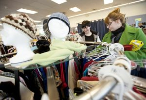 Customers Brianne Stoner, 16, left, and her mom, Shari Stoner, shop at the new Second Chance Thrift