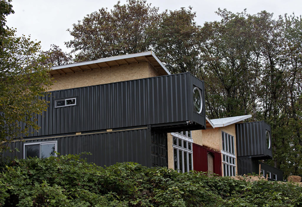 home partially made from shipping containers rising in. Black Bedroom Furniture Sets. Home Design Ideas