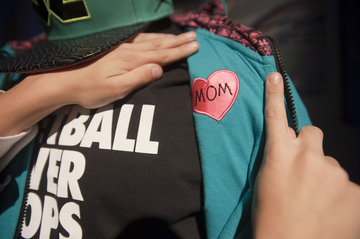 John Charles, 11, of Hockinson, included a heart-shaped patch reading mom on the inside of a Nike hoodie he designed as part of the Doernbecher Freestyle