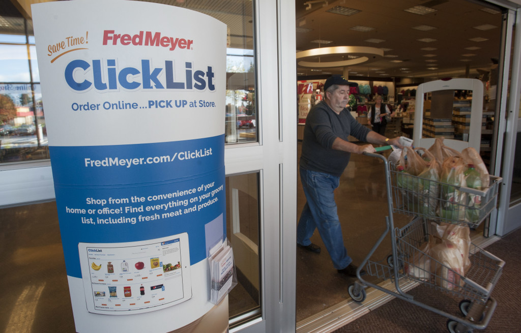 A Shopper Pushes A Grocery Cart Past A Sign Welcoming Shoppers To  Participate In Online Grocery Shopping At Fred Meyers In Vancouver Tuesday  November 3 ...