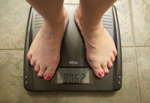Laina Harris steps on the scale in her Camas home Wednesday. Harris weighs herself every day to moni