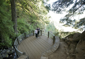 Laina Harris, right, and her friend Rondie White take photos at the top of the Multnomah Falls trail