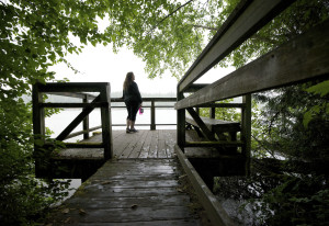 Laina Harris pauses during a walk on Heritage Trail to look out over Lacamas Lake in Camas on Wednes