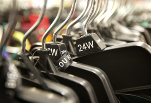 Laina Harris looks through the clothing racks at a department store Tuesday while shopping for a par