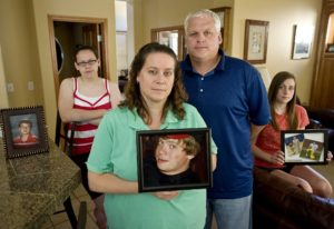 Scott Driscoll, center right, and his family experienced the death of son Quinn, 13, on June 10, 200