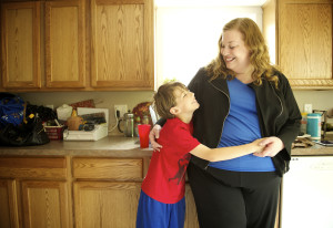 Laina Harris shares a moment with her 10-year-old son, Cameron, in the kitchen of the family's