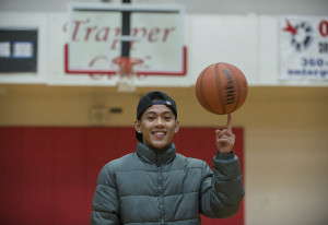 A.J. Yosuo, 17, spins a basketball on his index finger Dec. 17 at Fort Vancouver High School.  A.J.