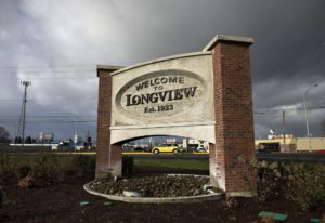 A motorist passes a sign welcoming visitors to Longview on Friday morning, Jan. 29, 2016  (Amanda Co