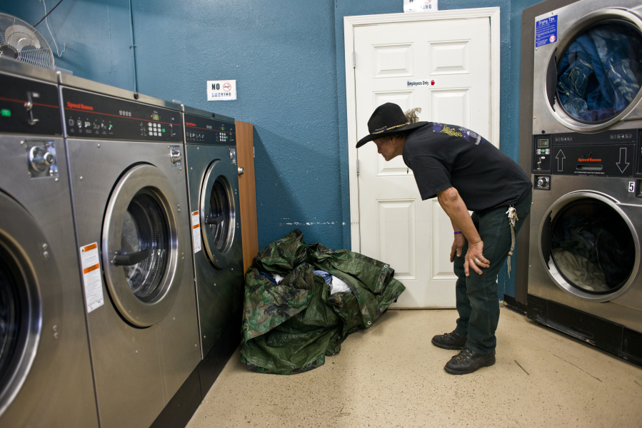 Rose village laundromats thursday night free washes help those in don st arnauld 60 waits for somebody elses load to finish so he can get his own underway at laundry love in rose village solutioingenieria Gallery