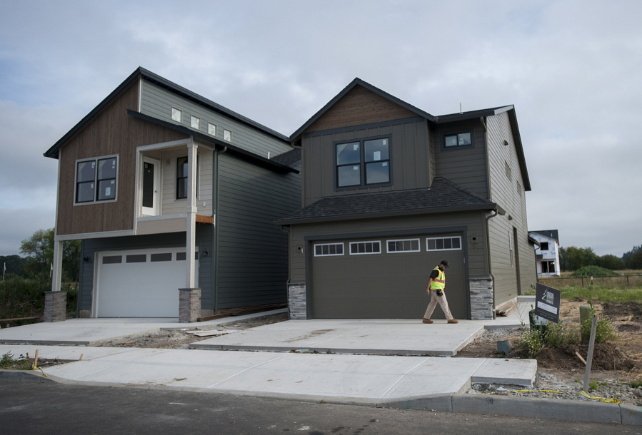denny benitez of pioneer cable walks past small homes under construction in vancouver by urban nw homes though some smaller new homes are on the market - New Small Homes