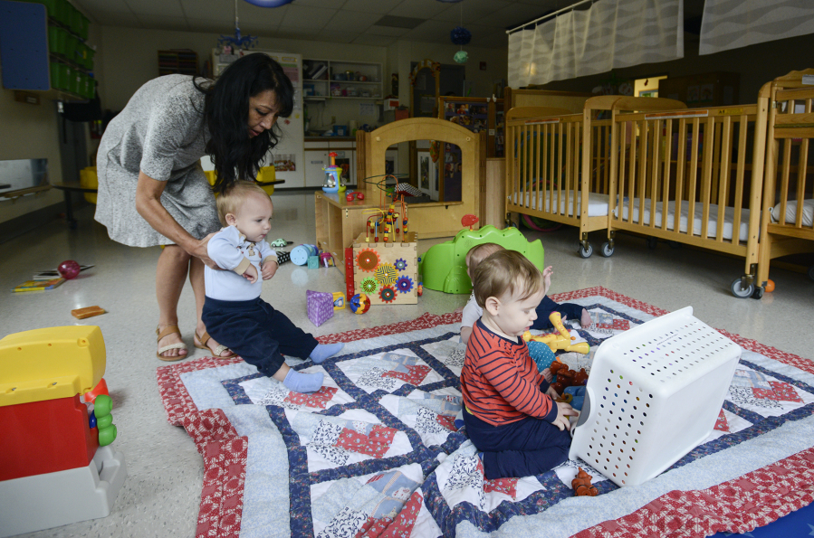 Jenny Goff Left Interacts With Infants Playing Thursday Morning At The Central Park Child Care Center In Vancouver Median Annual Cost Of Based