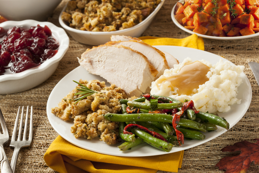 Homemade turkey Thanksgiving dinner with mashed potatoes stuffing and green beans. & Just how many calories are in that Thanksgiving meal? | The Columbian