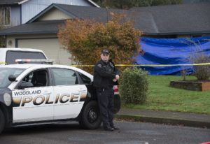 Officer Rudy Podhora keeps watch at the scene of a possible homicide in Woodland on Nov. 22, 2016.