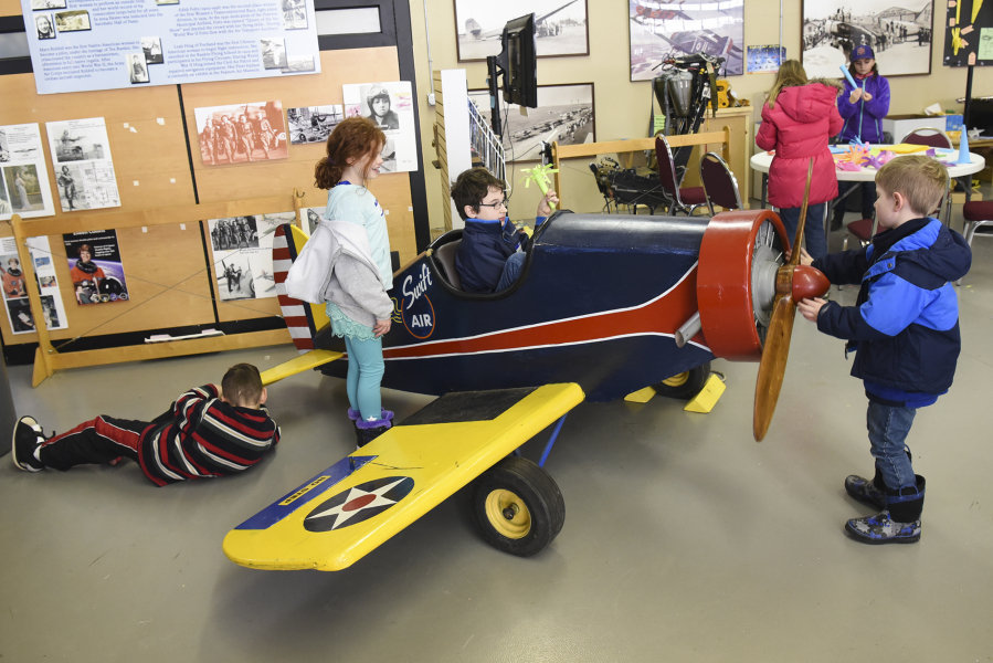 Camp lets kids play with principles of flight the columbian and julian charbonneau have fun with a kid sized mock up airplane tuesday during the aviation winter break camp at the pearson field education center sciox Choice Image