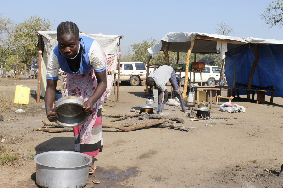 Fleeing war south sudanese create booming camps in uganda the a south sudanese refugee cooks food at a restaurant in the bibi bidi refugee camp in bidi bidi uganda about 440000 people have fled south sudans sciox Choice Image