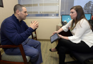 Dr. Jason Dranove discusses cancer treatment guidelines with genetic counselor Stacy Lenarcic at Car