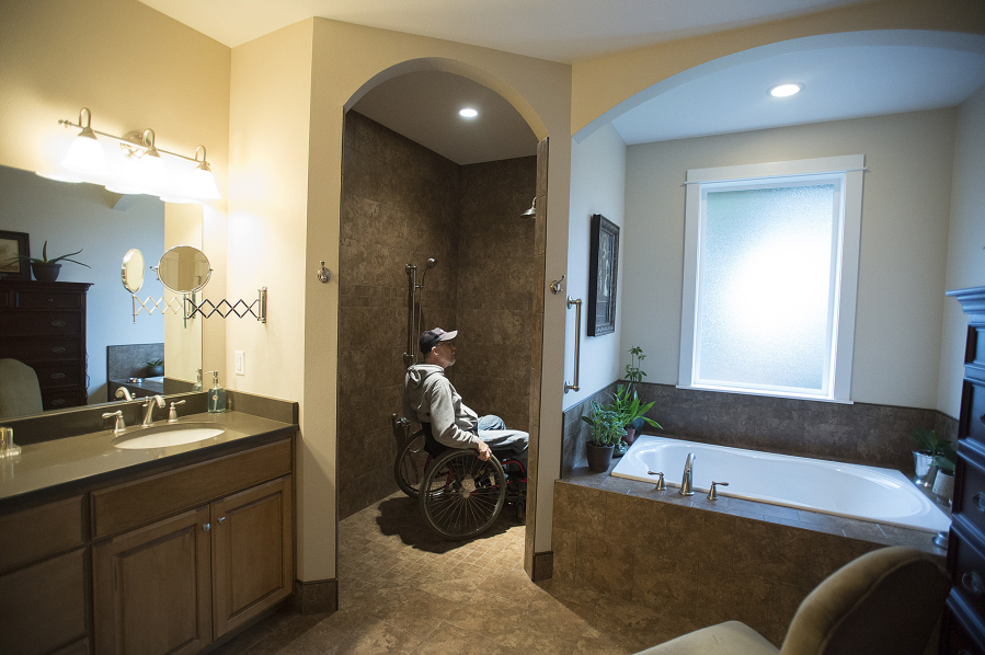 Chuck Frayer Of The Clark County Commission On Aging Looks Over The Walk In  Shower In Marian Andersonu0027s Hazel Dell Home Tuesday Morning.