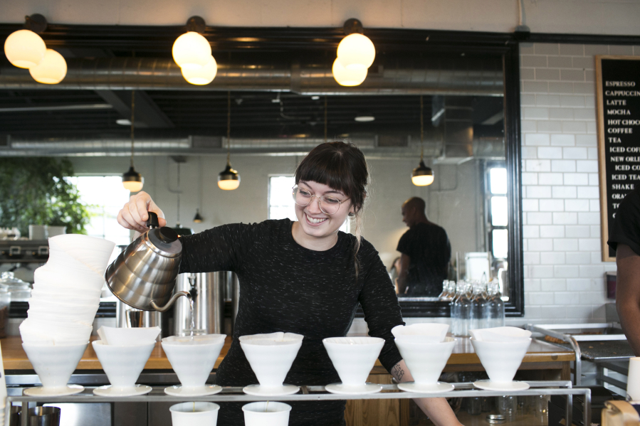 Katie Dorrian Crafts A Drink At Fox In The Snow, Where All The Coffee Is  Hand Poured In The Open.