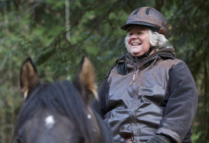 Whipple Creek Park Restoration Committee President Anita Will, on her horse Russell, shows some of t
