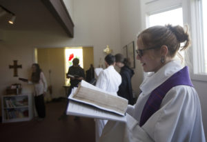 The Rev. Jessie Smith sings a hymn during a Sunday service in December at St. Anne's Episco