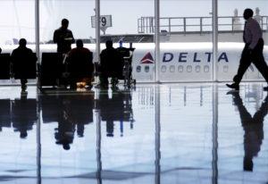 A Delta Airlines jet sits at a gate at Hartsfield-Jackson Atlanta International Airport in Atlanta i