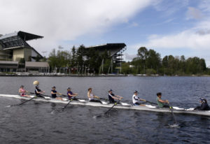 An 8-person rowing team practices on Lake Washington before the Windermere Cup in Seattle. The Unive