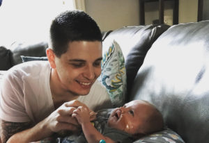 Jonas Lail plays with his son, Hudson, who died on June 1. A once-in-a-lifetime shot five days after