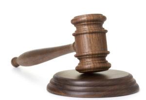 iStock.com Jurors in the jury box iStock Documents requesting jury duty with gavel.