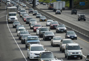 Traffic heads north (left) and south (right) in Portland on Interstate 5 in April 2015. Oregon has m