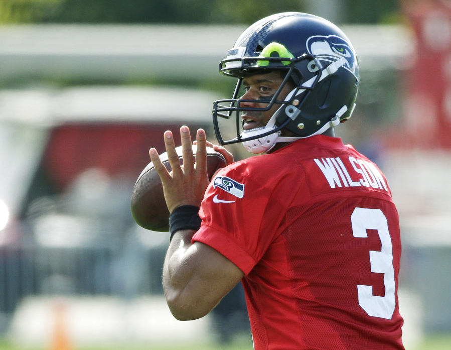 Seahawks open camp minus mcdowell the columbian seattle seahawks quarterback russell wilson passes during an nfl football training camp sunday july 30 2017 in renton wash ap phototed s warren sciox Choice Image