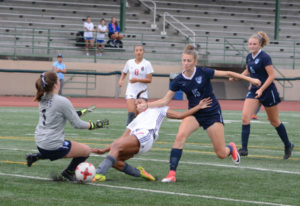 Union's MaKayla Woods, center, attempts to shoot past Gig Harbor goalkeeper Auna Havens on Thur