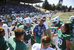 Mountain View head coach Adam Mathieson talks to his team during game vs. Ferris on Saturday afterno