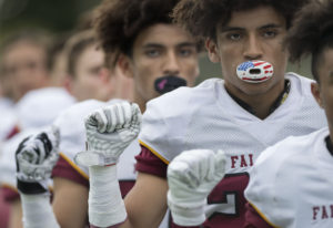 Prairie's Zeke Dixson, background, and AJ Dixson, foreground, raise their fists during the sing