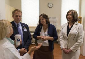 Imaging manager Julie Bogh, left, Legacy Salmon Creek Medical Center president Bryce Helgerson, brea