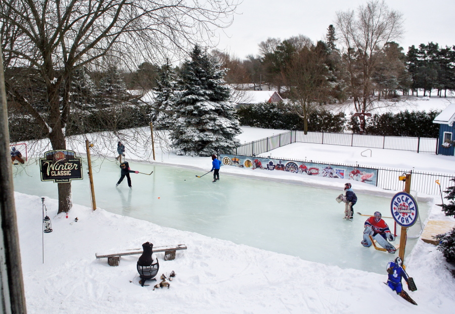 Skaters Playing Hockey On The Brown Familyu0027s Backyard Ice Rink In Toronto.  Brown Family/Iron Sleek