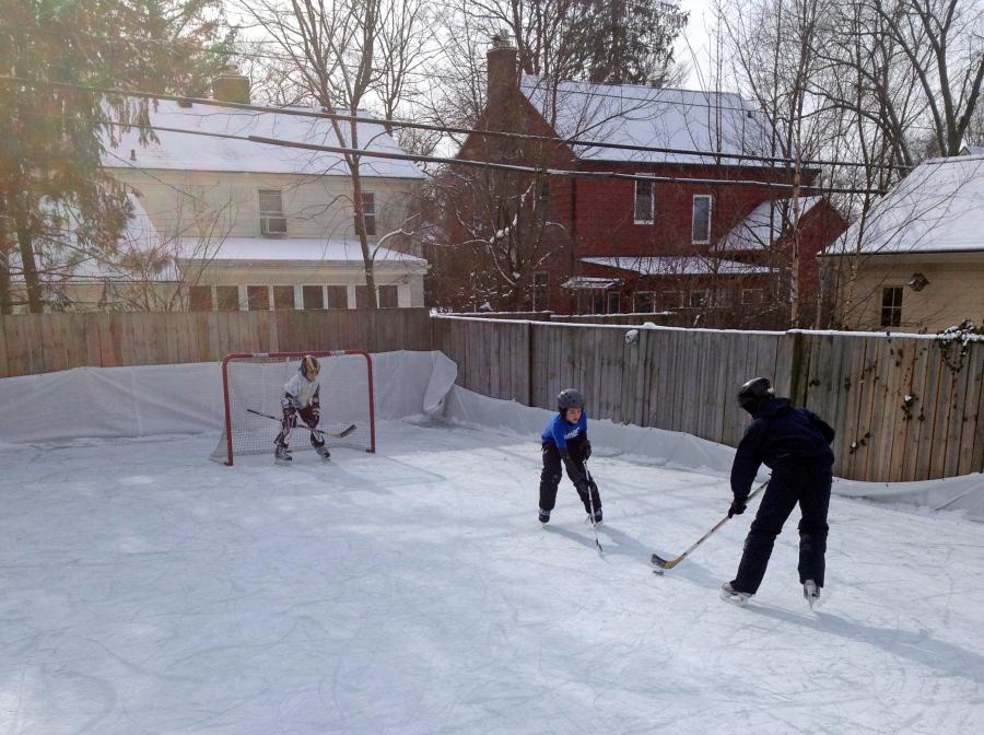 Members Of The Rubin Family Play Hockey On Their Backyard Ice Rink In The  Burns Park Neighborhood Of Ann Arbor, Mich. John Rubin
