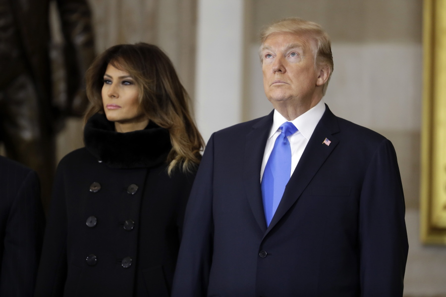 President Donald Trump and first lady Melania Trump, arrive to participate  in a ceremony honoring Reverend Billy Graham in the Rotunda of the U.S.  Capitol ...