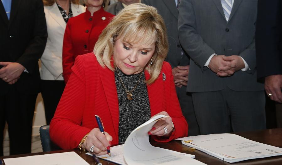 Oklahoma Gov. Mary Fallin signs revenue bills and a teacher pay raise bill in Oklahoma City Thursday