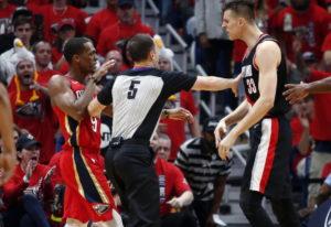 New Orleans Pelicans guard Rajon Rondo and Portland Trail Blazers center Zach Collins (33) confront