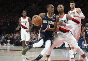 New Orleans Pelicans guard Rajon Rondo, front left, drives against Portland Trail Blazers guard Dami