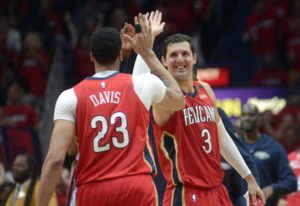 New Orleans Pelicans forward Nikola Mirotic (3) celebrates with forward Anthony Davis (23) during th