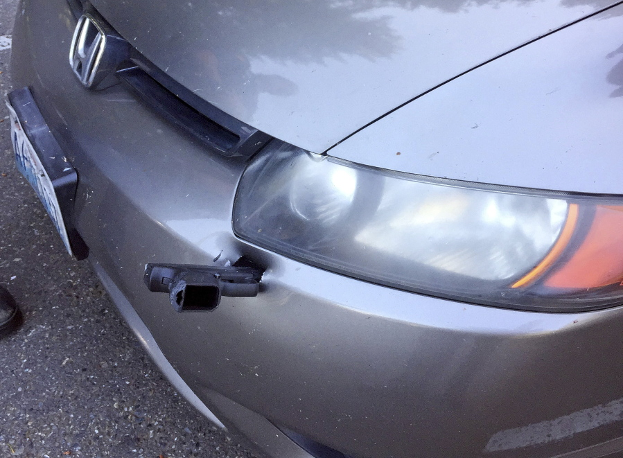 Man Discovers Handgun Impaled In Front Bumper Of Car