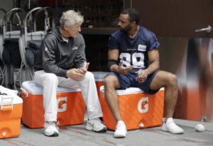 Seattle Seahawks wide receiver Doug Baldwin, right, talks with head coach Pete Carroll, left, follow