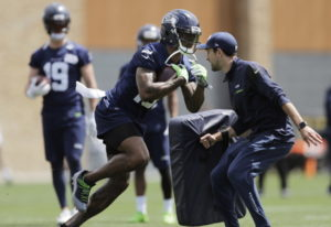 Seattle Seahawks wide receiver Brandon Marshall, center, runs a drill during NFL football practice,