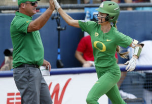 Oregon's Haley Cruse (26) high-fives coach Mike White after hitting a two-run home run against Arizo