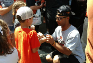 Oregon State's Preston Jones signs autographs Friday in Portland, where a rally was held to celebrat
