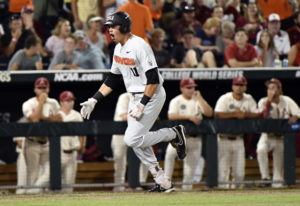 Oregon State's Trevor Larnach (11) celebrates his two-run home run against Arkansas during the