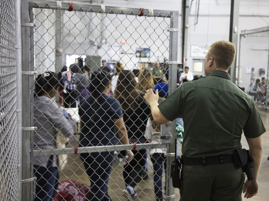 Hundreds of children wait in Border Patrol facility in Texas